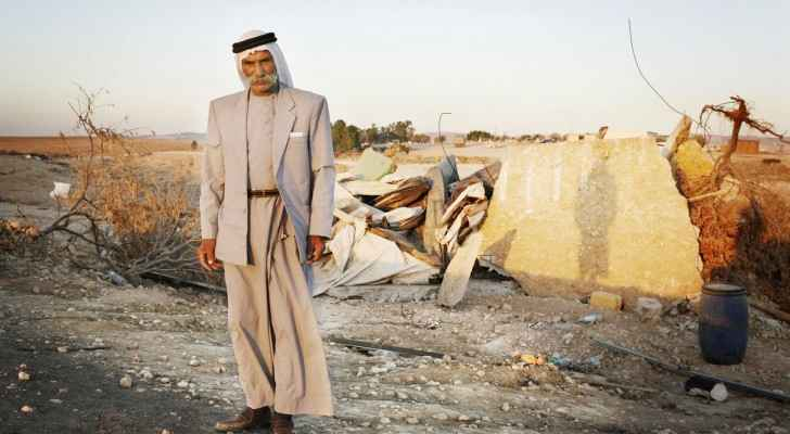 Sheikh Sayah Al-Turi, one of Al Araqib village residents in front of his demolished village. (Image from: The Institute for Middle East Understanding)