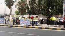 Dozens demonstrate against law punishing children of foreign fathers