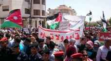Jordanians demonstrate in support of Palestinians and Al Aqsa near Israeli Embassy