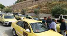 Taxi drivers in Salt stage a protest