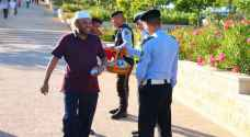 Traffic police gift greeting cards and sweets to mosquegoers during Eid