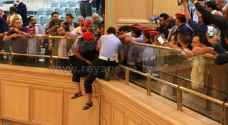 Civilian jumps from the Lower House gallery to meet Razzaz