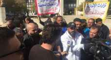 Coffee stall owners demonstrate outside GAM