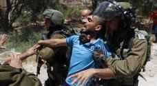 Israeli Occupation authorities assault elderly man, arrest his son