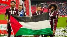 Leicester City FC players celebrate FA Cup win with Palestinian flag