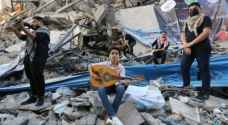 PICTURES: Young Palestinians hold musical performance on tower ruins in Gaza
