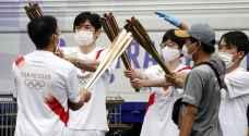Olympic flame arrives in Tokyo after 'heartbreaking' fan ban