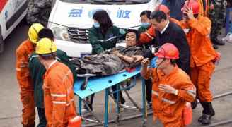 Two killed, 20 trapped in collapsed Chinese coal mine