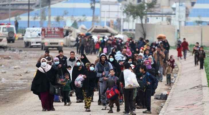 Displaced residents of western Mosul flee their neighborhood on March 15, 2017. (AFP)