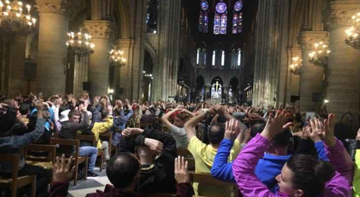 Police ask people inside Notre-Dame Cathedral to raise their hands after a man attacked a police officer nearby.