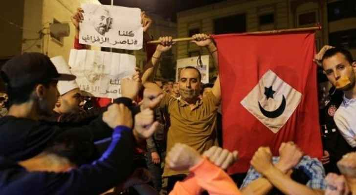 Thousands take to the streets in the northern Moroccan town of Al-Hoceima, demanding release of a prominent activist.