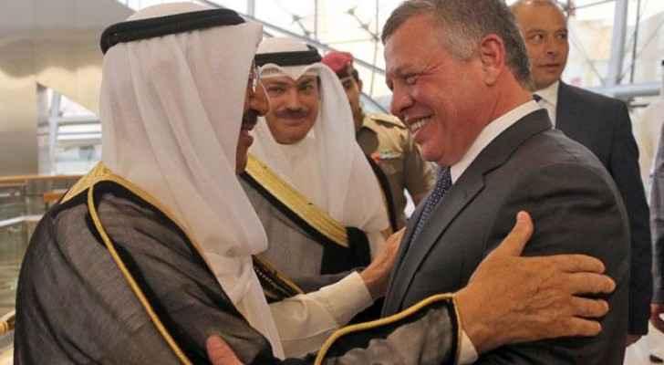 His Majesty King Abdullah is received by Kuwaiti Emir Sheikh Sabah Al Ahmad Al Sabah in Kuwait last year. (Jordan Royal Court)