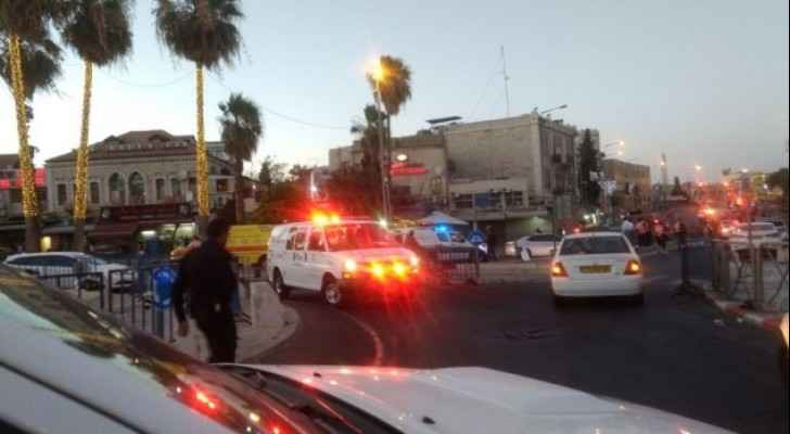 Israeli officer stabbed, and three attackers shot in Jerusalem.