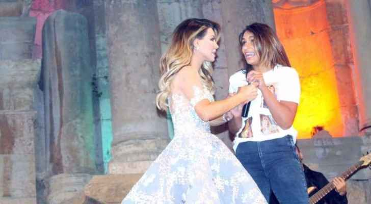 The female fan tried to grab the microphone away from Nawal's hand.