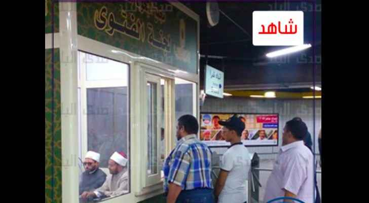 Egyptians line up to ask questions at the Fatwa booth. (Sada ElBalad)