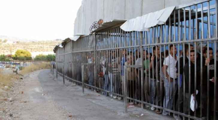 Lining up at Bethlehem checkpoint.