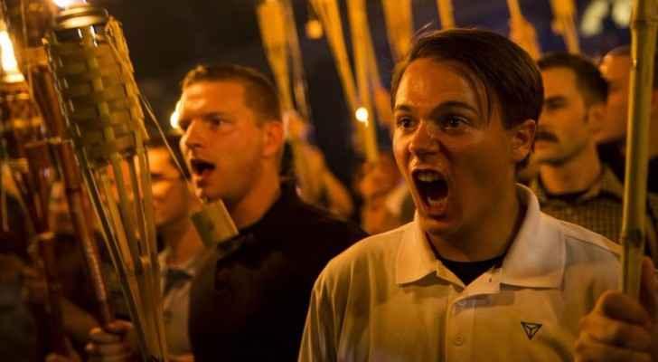 Far-right groups including KKK members chanting anti-Jewish slogans in Charlottesville. (Photo Credit: LogoTV)