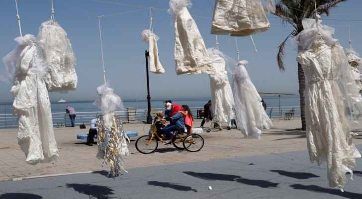 Art installation in Beirut protesting the law using wedding dresses. (Photo Credit: AP/Hussein Malla)