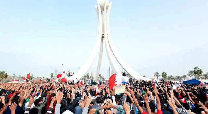 Protesters in Bahrain around the Pearl Roundabout  in February 2011. (Photo Credit:  BBC)