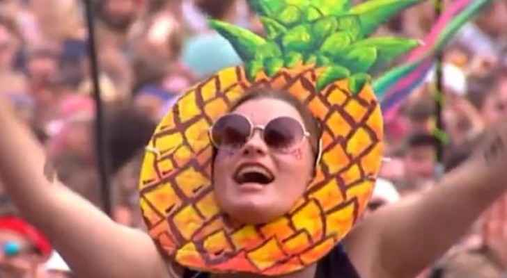 Glass Animals fan standing in solidarity at Glastonbury. (Photo Credit: The BBC)