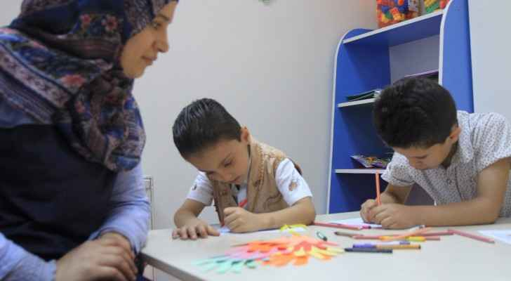 Children take art therapy sessions at the Sir Bobby Charlton Centre for Support and Rehabilitation, Amman. (Ro'ya)