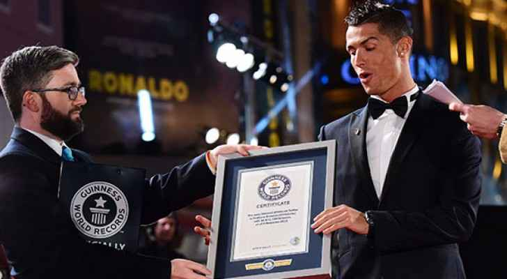 Christiano Ronaldo receiving a certificate from Guinness at the premier of his film in London (Photo Credit: Guinness) g