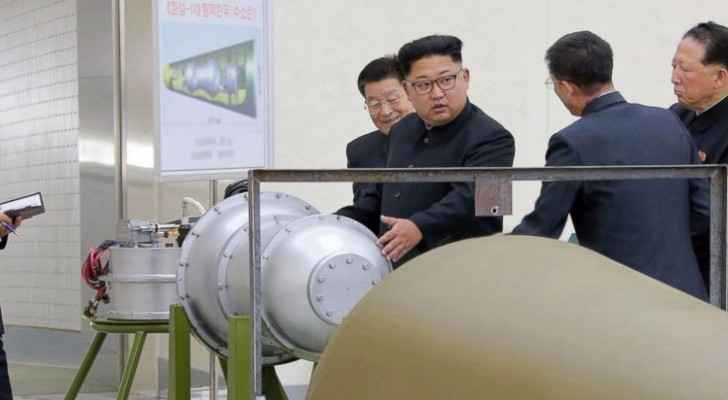 Picture released by North Korean government depicting NK leader Kim Jong-un overseeing the loading of a hydrogen bomb.