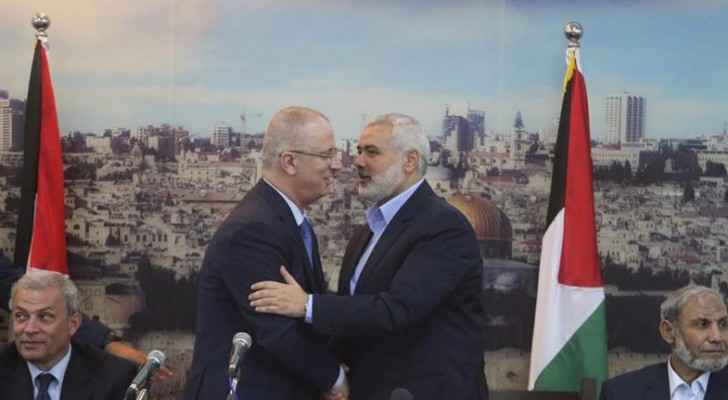 Palestinian Prime Minister Rami Hamdallah and Senior Hamas leader Ismail Haniya in Gaza city in 2014 . (Photo Credit: Reuters)