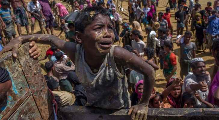 A Rohingya Muslim boy pleads with aid workers to give him a bag of rice. (Photo Credit: AP)