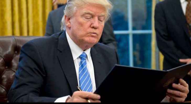 US President Donald Trump after signing the initial executive order. (File photo)