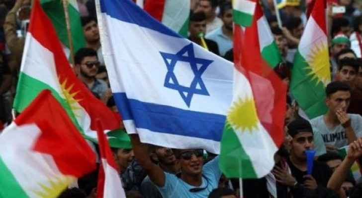 Iraqi Kurds fly an Israeli flag and Kurdish flags during an event to urge people to vote in the upcoming independence referendum. (AFP)