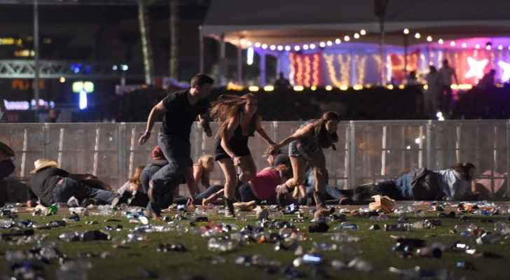 People run from the Route 91 Harvest country music festival in Las Vegas. (Photo by David Becker/Getty Images)