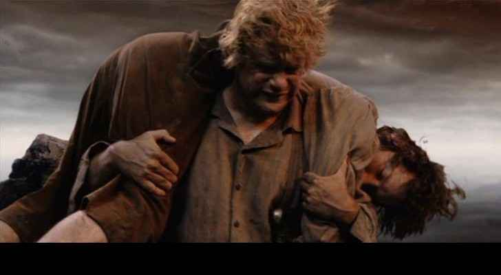 A scene from The Lord of the Rings where Sam is seen carrying Frodo. (Chapman.edu)