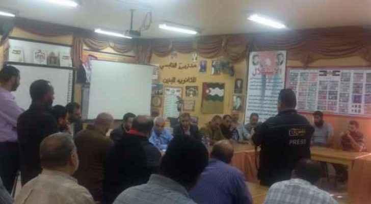 Teachers meet with education officials