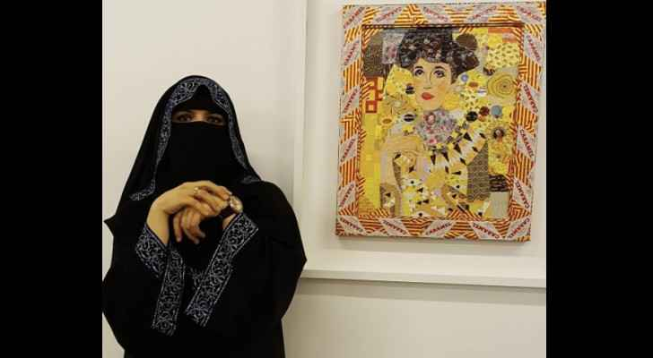 Ghada Al-Rabee poses with her artwork. (Instagram)