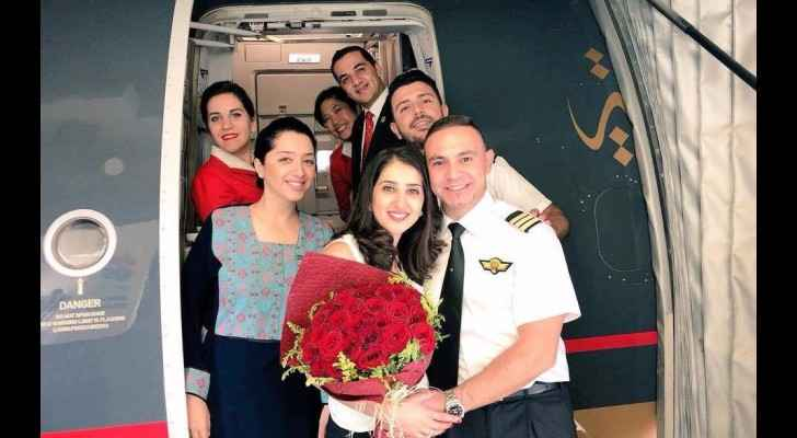 The couple with the airplane's crew. (Facebook)