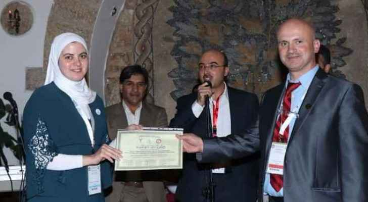 Dr. Ala' Abu Hijleh being honored by Dr. Wael Al 'izazy, head of the Jordanian Orthopedist Association