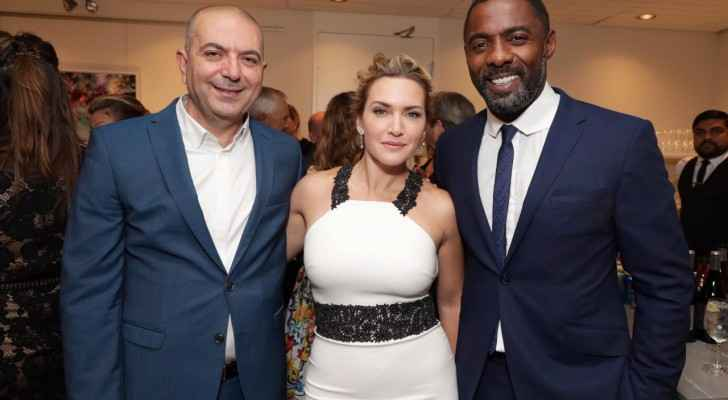 Hany Abu-Assad with his film's cast: Kate Winslet and Idris Elba.