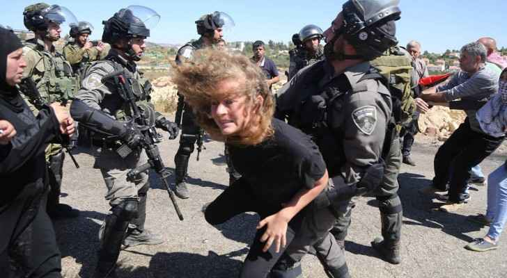 Old photo taken for Ahed Tamimi while trying to resist Israeli forces. (Archive)