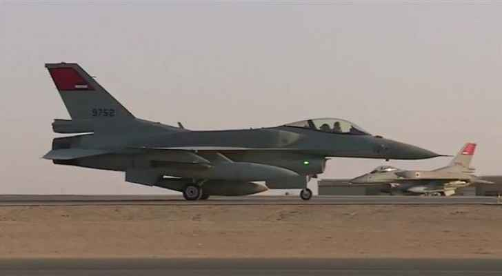 Egyptian air force F-16 fighter jet taking off from a runway.