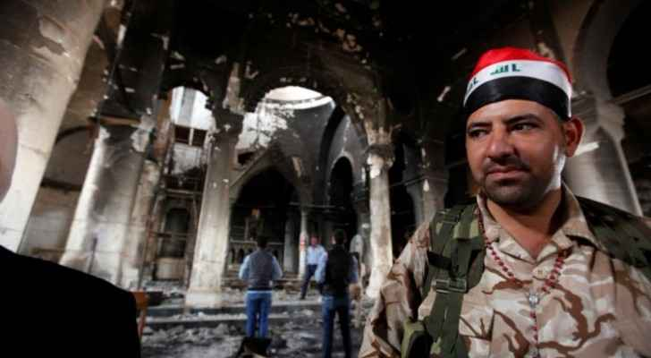 An Iraqi Christian soldier stands at the Grand Immaculate Church. (Christian Today Website)