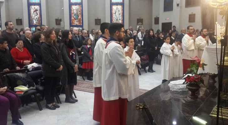 Jordanian Christians gathered to perform the Christmas Eve Mass. (ROYA ARABIC)