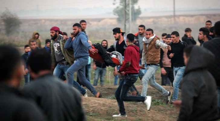 Palestinians carrying a wounded person during the Friday clashes with Israeli soldiers at the Gaza borders. One person died and at least 45 others wer