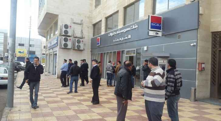 An image from outside the Societe Generale Bank Jordan in Al Wehdat area after the incident. (Roya)
