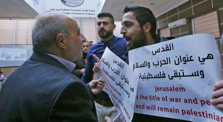 An activist shouting in one of the US officials' face after breaking out the meeting. (SocialMedia)