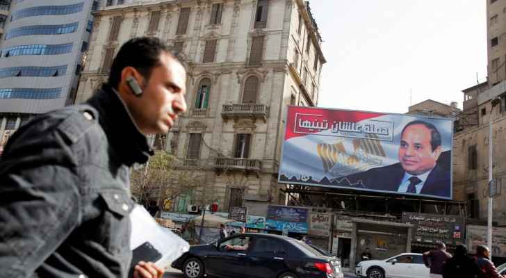 A picture shows a poster for Al-Sisi's campaign