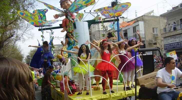 Jews celebrating Purim holiday. (Wikimedia)