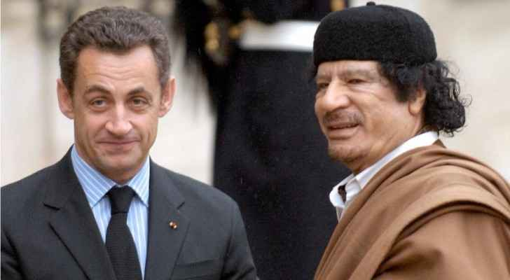 Former French President Nicolas Sarkozy with the late Libyan leader Muammar Gaddafi