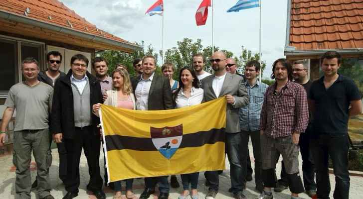 Vit Jedlicka with supports holding the flag on Liberland (24sata)
