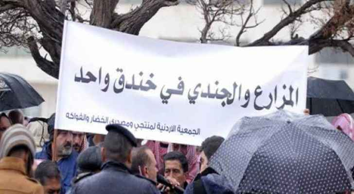 """Banner reads: """"The farmer and the soldier lie in one trench."""" (File photo)"""